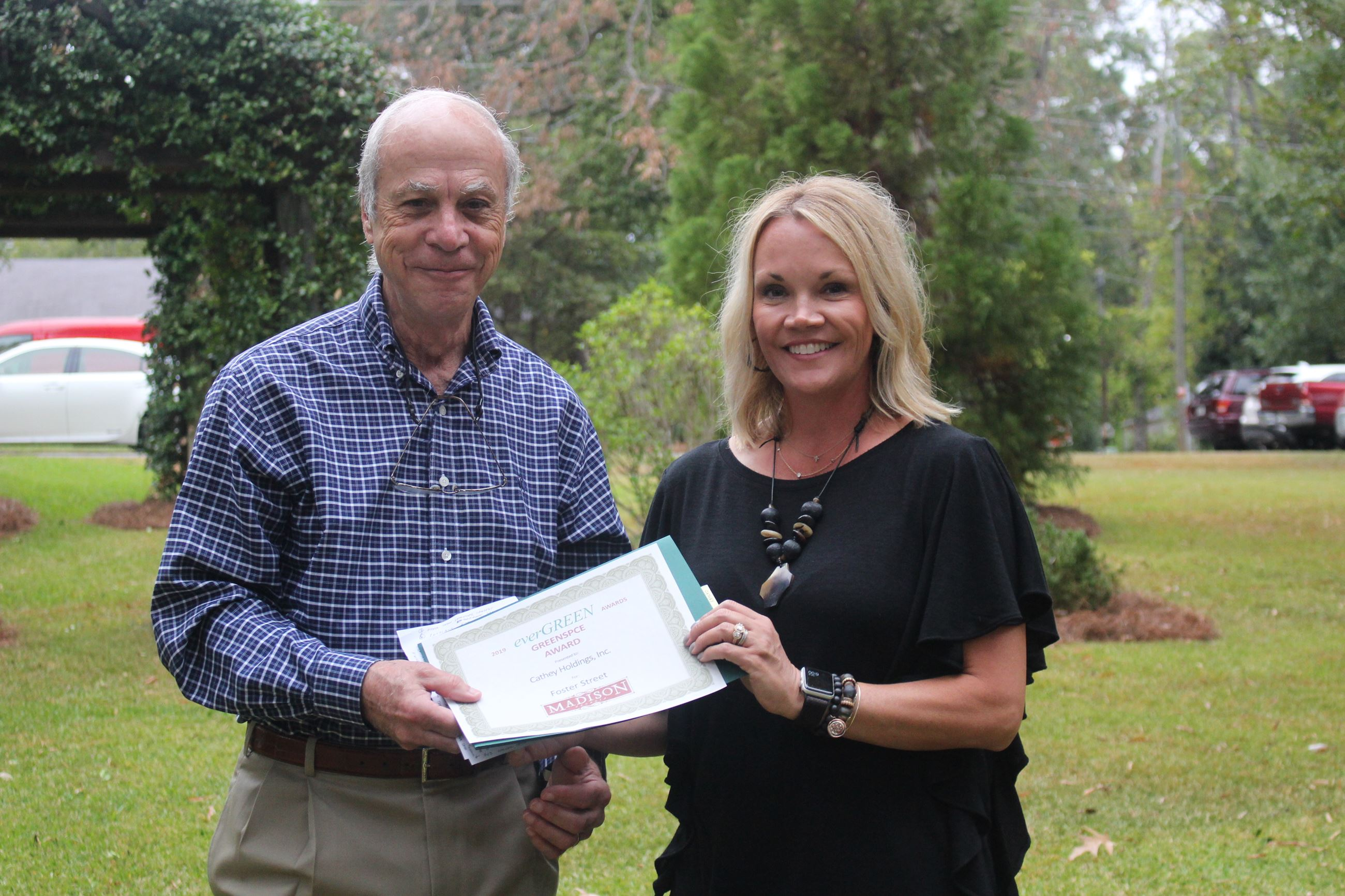 Beth Cathey of Cathey Holdings, Inc. receiving the Greenspace Award from David Land